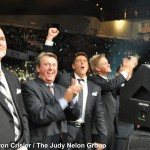 Danny Funderburk, Ernie Haase, and Devin McGlamery applaud and cheer for talent on the main stage.